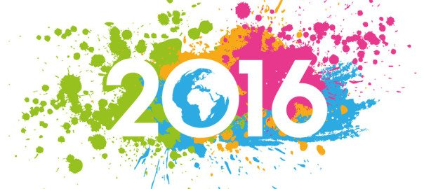 New Year 2016 date on colorful paint stains with the world map